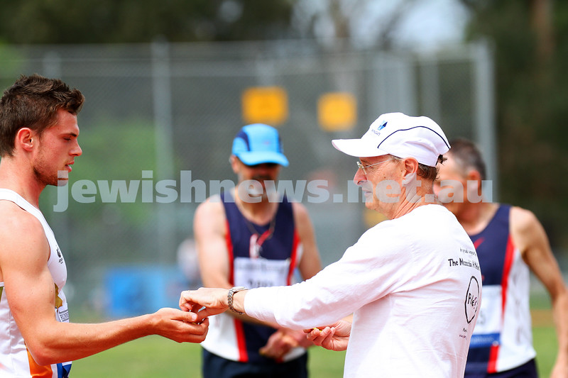 25-10-14. Maccabi athletics. Athletics Victoria Shield. Knox Athletics Track. Len Bogatin hand out finishing tokens for the 1500.  Photo: Peter Haskin