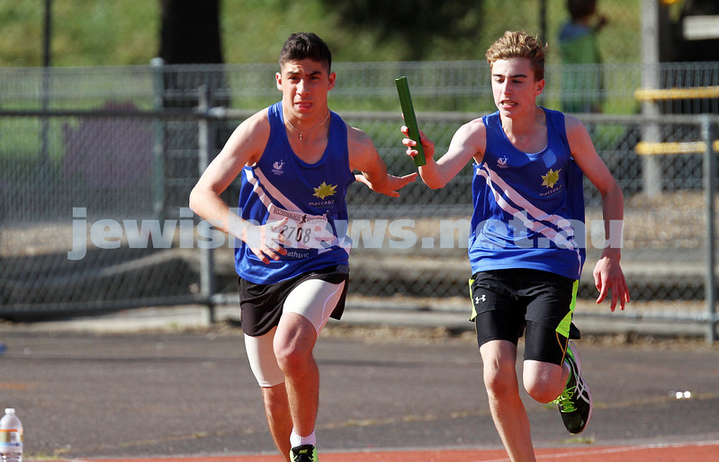 25-10-14. Maccabi athletics. Athletics Victoria Shield. Knox Athletics Track. Gideon Goldberg hand the baton over to Asher marks in the U 16 Boys 4 x 100. Photo: Peter Haskin