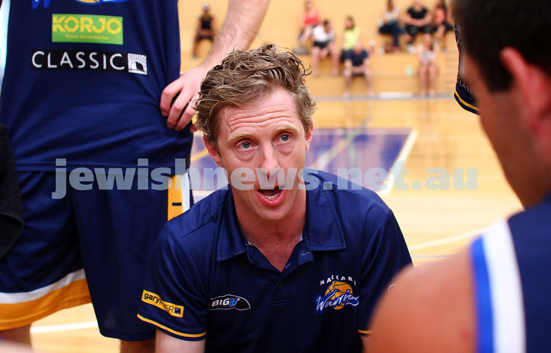 22-3-15. Maccabi Warriors v Craigieburn Eagles at Bialik College.  Coach Daniel Sherr adresses his players during a time out. Photo: Peter Haskin