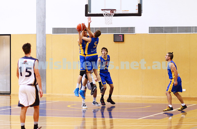 22-5-16. Maccabi Warriors lost to Pakenham Warriors 71 - 82 at Bialik Stadium.  Yariv Amiram (left), Benji Tamir fighting for a rebound. Photo: Peter Haskin