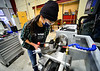 Oskar Lehnartz, an 11th grader at Brattleboro Union High School, uses the lathe at the machine shop at the Windham Regional Career Center, in Brattleboro, Vt., on Tuesday, Dec. 8, 2020.