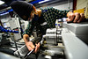 Oskar Lehnartz, an 11th grader at Brattleboro Union High School, uses a caliper to check the measurements on a project he is working on at the machine shop at the Windham Regional Career Center, in Brattleboro, Vt., on Tuesday, Dec. 8, 2020.