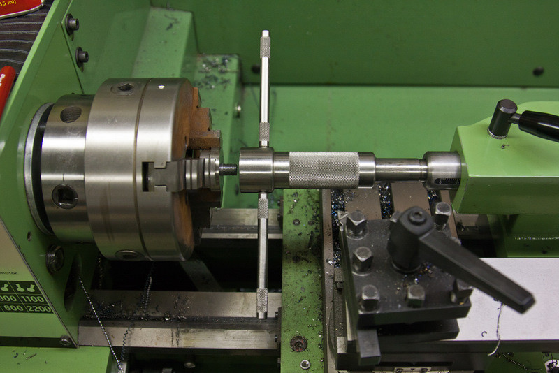 Machine work on the trunnions under way in the lathe, with the threading being completed.