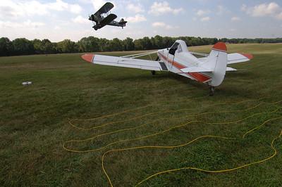 Piper Pawnee and biplane