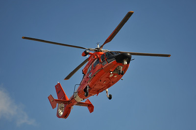 USCG HH-65 returning overhead from its demo flight.