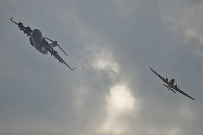 C-17 and C-47 in a bank overhead.