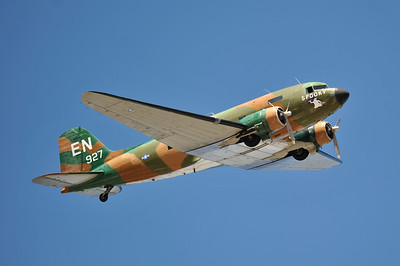 C-47 flies past.