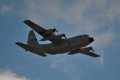 C-130 Hercules carrying (5) Airborne paratroopers.