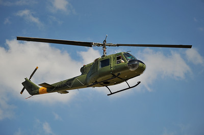 Marine Huey flies past.