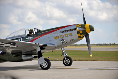 P-51 Mustang idling on the taxiway.
