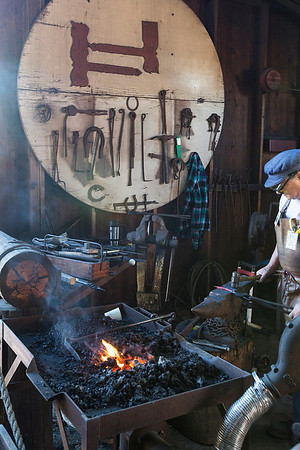 The blacksmith 'improving' the food retaining device of a early American rotisserie.  I have to agree with his assessment that the retaining mechanism is critical to being able to eat the food you placed on the rotisserie.