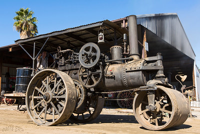 Steam tractor heading over to run the thresher.  Since the engine finally started running relatively smoke free by this point, I want to at least show something was moving, hence the slow shutter speed to allow the gears to blur slightly.