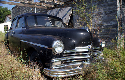 A 1949 Plymouth Deluxe sedan sitting at an abandoned gas station in Mankins, TX.