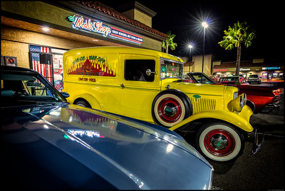 A couple of cars parked in front of Classic's Malt Shop during a recent car show.