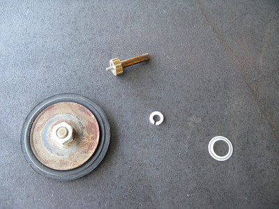 These are the basic innards of a regulator.  What is not shown here is the cap for the plunger.
