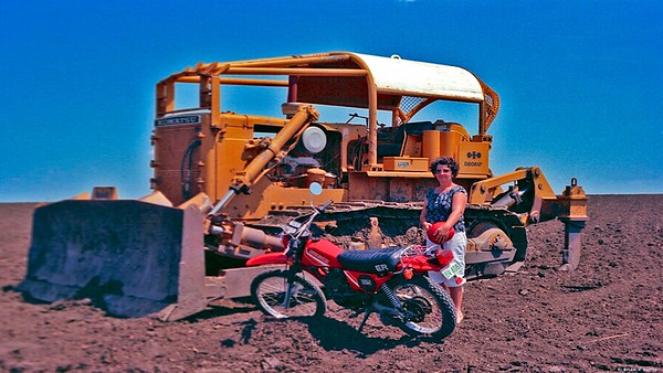 Brian & Barbara do a irrigation farm tour on our Suzuki 185-ER soon after arriving Emerald 1983