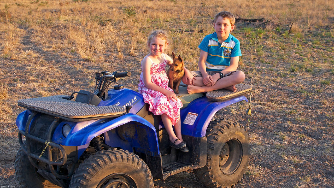 Paige at Talafa with neighbour's son Kobie and his mate. He is quite handy with his dad's quad and helps out a lot.