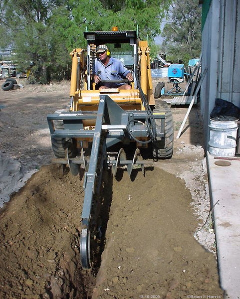 To get the 240 volt power up to our Buffalo shed, we have to get a deep trench dug. I was able to put the orange poly conduits down well over a metre. Put the warning tape above that and  my blue striped 'bullet proof' poly pipe about half a metre above that. We got a professional in to dig the trench with a magic Case chain trencher. A sparky did the legal hook up for us. Certified.