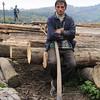 The lumberjack.<br /> Behind him are the logs cut down on Valea Novatzului and brang here by narrow gauge trains. Viseul de sus, 2004