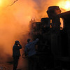 Heating up the steam engines, before the ride towards forests. Viseul de sus, Maramures, Romania, 2004, 5-30 am<br /> This is the last narrow gauge steam traction railway in Europe