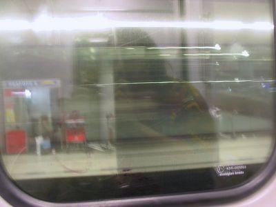 A self portrait in the window of a train
