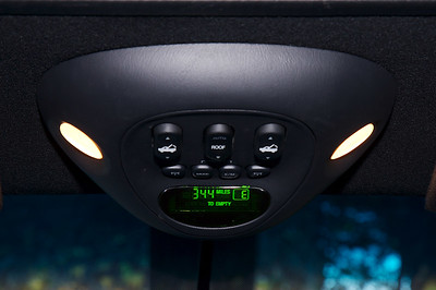 Overhead console with courtesy lights