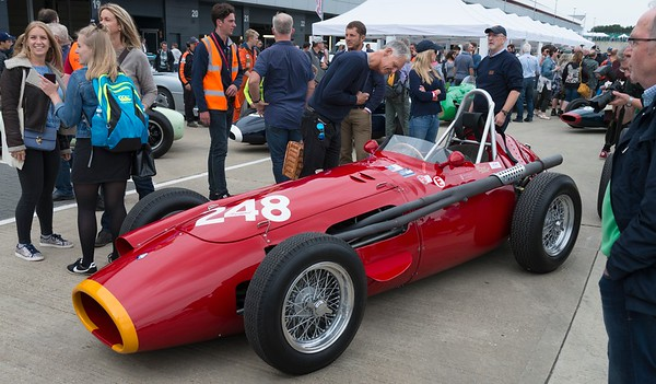 Gathering around the 1957 Maserati 250F CM5  at the Silverstone Classic 2017