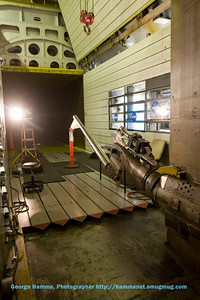 This is another view of the force balance, angle-adjusting sting, and test article looking upstream in the test section of the wind tunnel.
