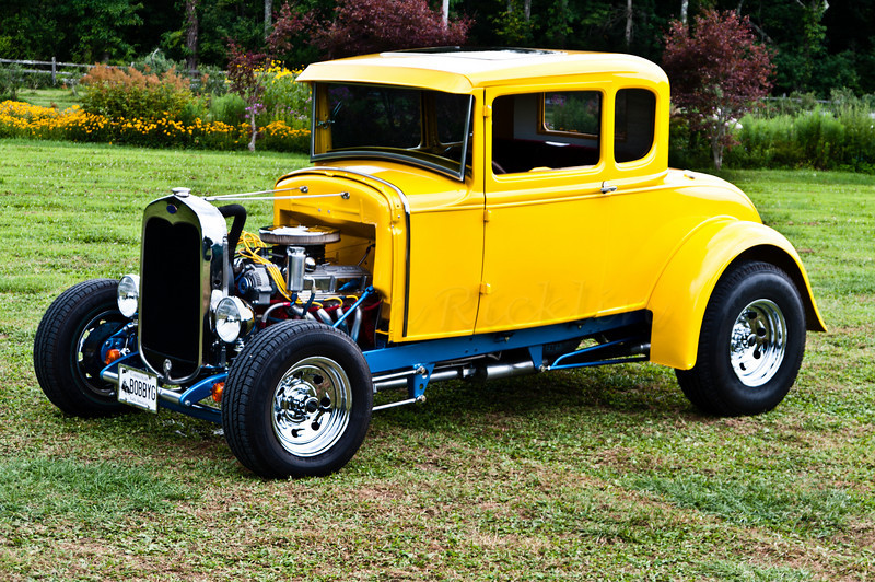 Souped up Ford in yellow, blue and chrome.