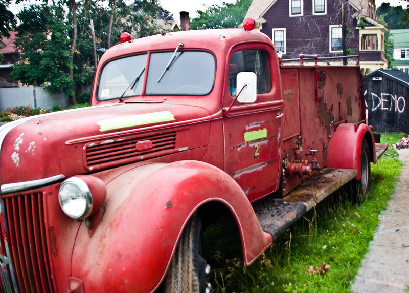 Old '40's Ford Fire Truck-by burnt out building