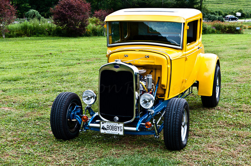 Souped Ford in yellow, blue and chrome.