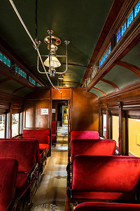 The refinished passenger car attached to the mail car.  This had segregated seating, though from what's in the car there is no difference between the two except location.  What really caught my eye early on was the blue glass windows along the top of the cabin.