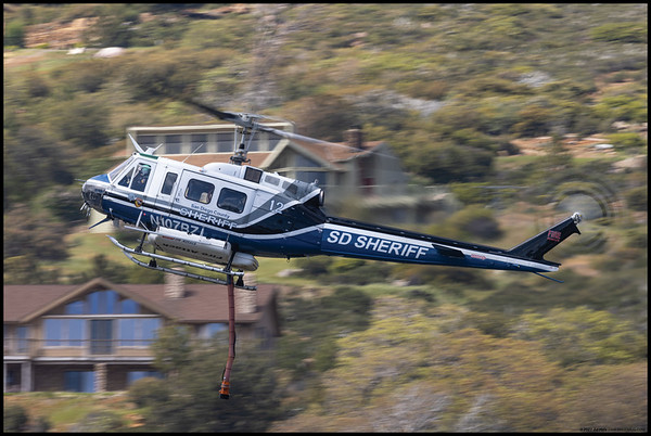 One of the San Diego Sheriff's Bell 205 A1 helicopters during its descent to fill the belly tanks from Lake Cuyamaca. It, along with two other helos, was fighting the Southern Fire in Shelter Valley while the fixed wing aircraft were grounded due to high winds.