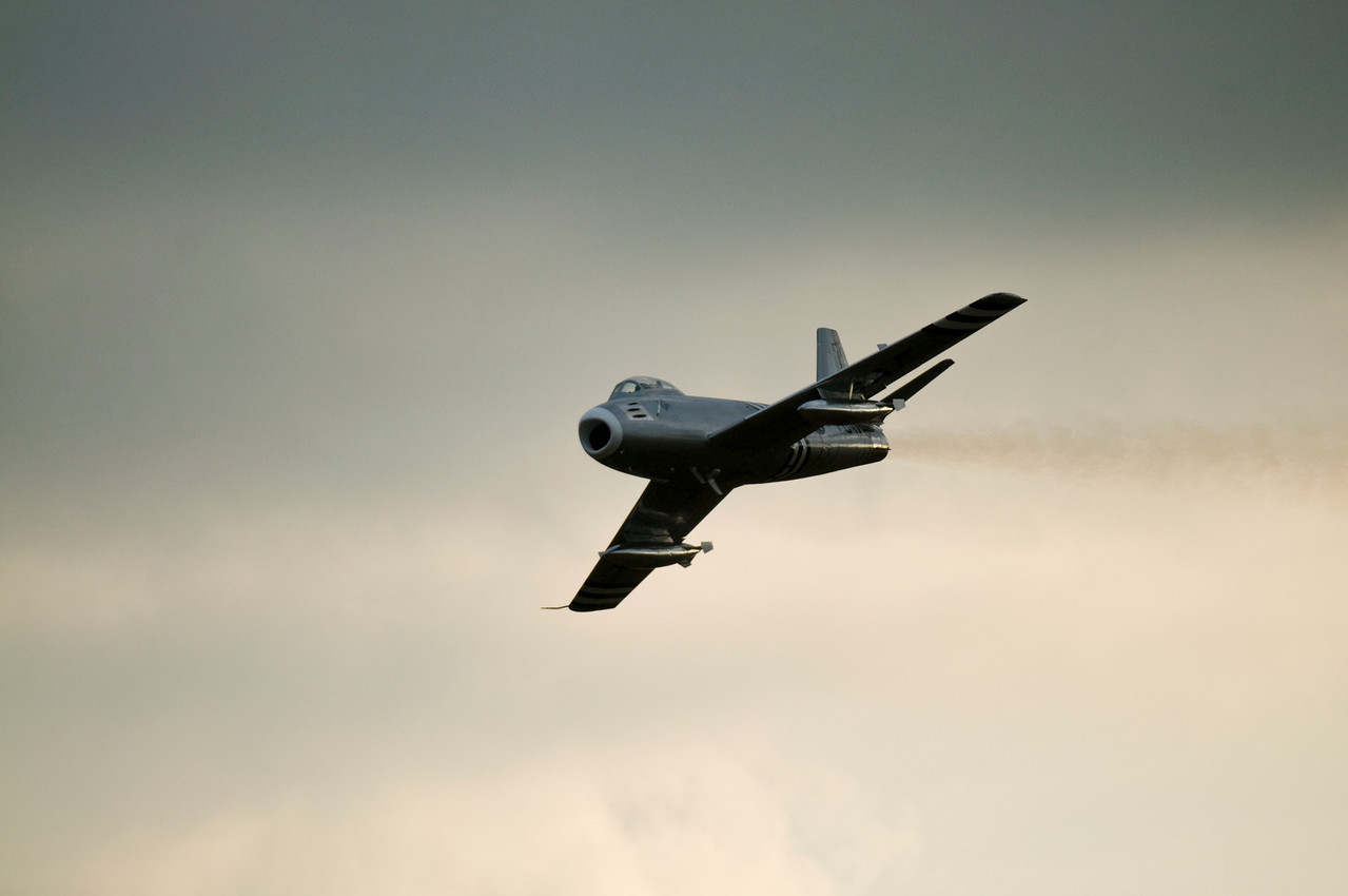 F86 Sabre at Duxford 2011. There's something heartwarming about the amount of fuel being blown from the jet engine.....