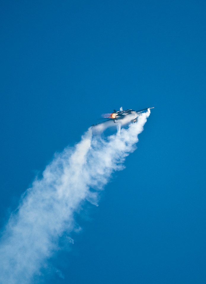F16 topping out an inside loop. The vectored thrust is not inline with the plane and you can see from the condensation that he's moving upwards as much as forewards.