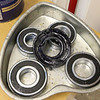 Bearings repacked and the seal lip also packed with grease, reassembled and headed for the freezer while we disassemble the tub, to shrink them a skosh and ease reassembly