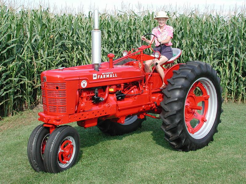 Charlie feels right at home; she logged many hours in the seat as her Dad's farmhand. He bought this tractor new and we restored it for his 92nd birthday in '03.
