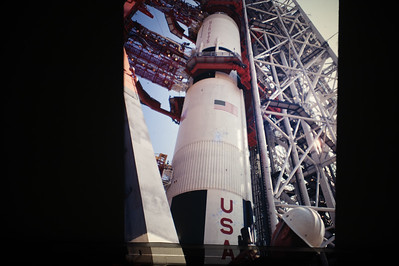 Miles Ross, Deputy Director of the Kennedy Space Center, looks up from the launch platform at a Saturn V