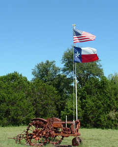 Tractors and flags seem to naturally go together like this one near Iredell, TX. ~ mg