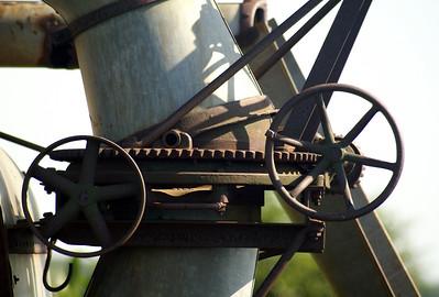 Close-up of gears on a threshing machine near Burt, IA.