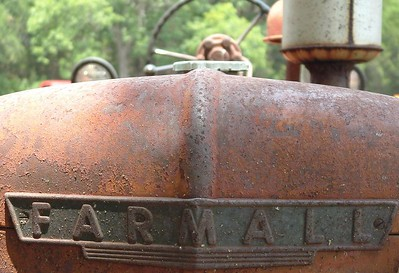 Farmall plate on tractor at Glen Rose, Texas