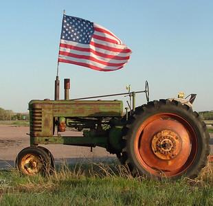 A patroitic tractor near Lewellen, NE. ~ mg