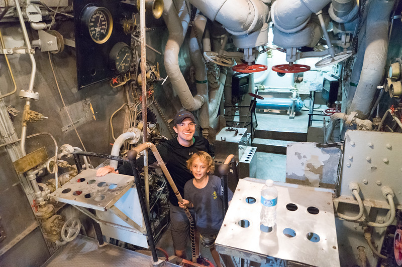 In machine room #1, which houses two boilers, high & low speed steam turbines, and reduction gears to drive one of the ship's four propellers.