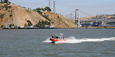 Coast Guard 25' Defender Class boat, with Carquinez Bridge in background.  San Pablo Bay, CA.  30 Jun 2008.