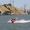 Coast Guard 25' Defender Class boat, with Carquinez Bridge in background.  San Pablo Bay, CA.  30 Jun 2008.