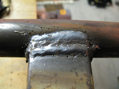 This is starting to look like other welds I have seen only slightly more weldified.  A lot of that was unnecessary, but I was noticing that my beads were looking better so I did some extra ones.
