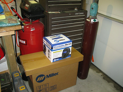 I picked up a 125cf bottle of 75% Argon and 25% CO2 from Gerken Rental in Paola, KS.    The thinner box has the welding cart in it.  The helmet is Miller's least expensive auto-darkening model.  I bought it at Praxair in Olathe, KS.