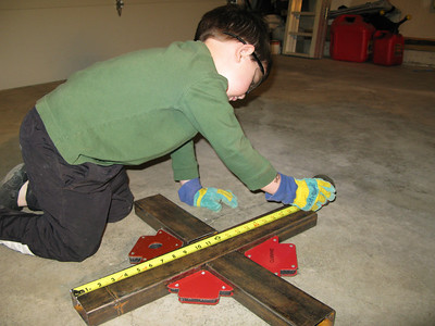 Here we are trying to determine the center point and mark it for aligning the two cross bars.