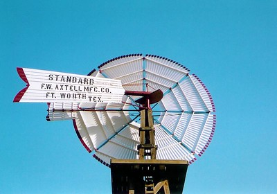 Old windmill with wood fan and tail built by the Standard F.W. Axtell Mfg. Co. Fort Worth, TX. bsg