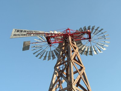 A rare, working twin wheel windmill located in the American Wind Power Center in Lubbock, TX.  This windmill was manufactured by the Twin-Wheel Windmill Manufacturing Co. in Hutchinson, Kansas.  It consist of two 10' fans. - mg
